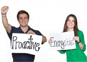 """BKS Colleagues holding up sighs that read """"proactive"""" and """"energetic"""""""