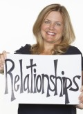 "Elizabeth Krystyn, BKS Founding Partner holds sign that reads ""relationships"""