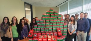 BKS collegues group around donated holiday gifts