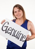 "BKS Senior relationship manager holds sign that reads ""genuine"""