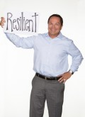 "BKS Colleague, Mike Ortoll holds sign that reads ""resilient"""