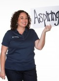 """BKS Colleague Nadia Roman holding a sign that reads """"aspiring"""""""