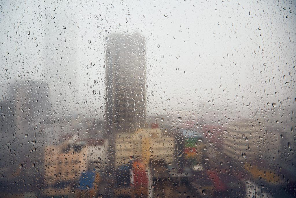 Rain in the city and selective focus on the drops - Skyline of city