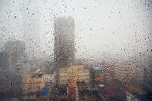 Rain in the city and selective focus on the drops - how to prepare for a catastrophe