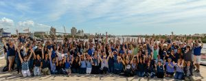 BKS Partners team group photo in front of water in Tampa