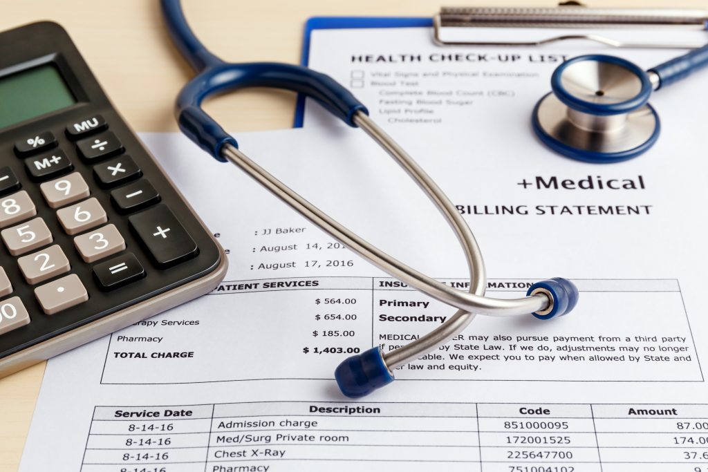 medical bill with stethoscope and calculator symbolizes employer healthcare spending
