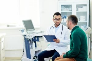 physician provides direct primary care to patient in doctors office