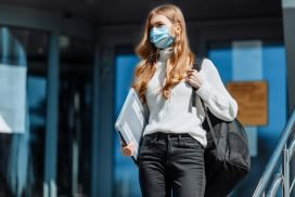 young woman in face covering return to work