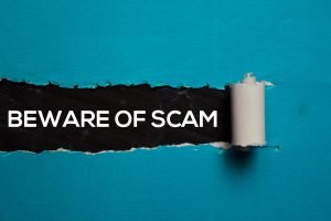 beware of scam text uncovered by peeled sign for disaster fraud