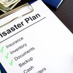 disaster plan checklist on cipboard 8 ways to prepare your business for a natural disaster