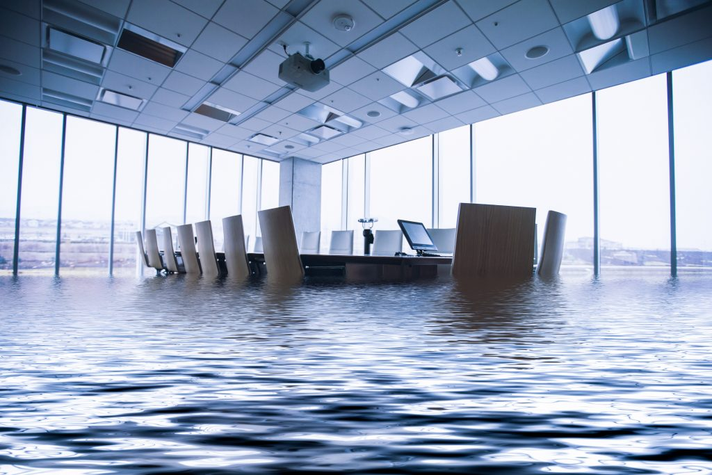 flooded conference room protected by commercial flood insurance